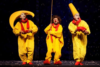 """Clowns perform during a scene from the media preview of the stage spectacle """"Slava's Snowshow"""" at the Sands Theatre at the Marina Bay Sands in Singapore"""